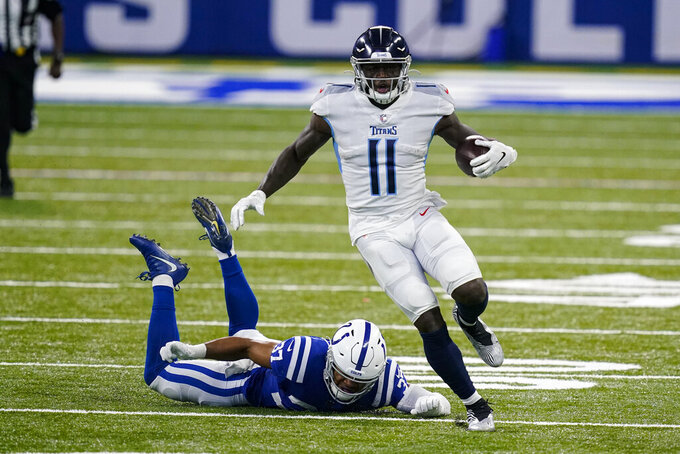 Tennessee Titans wide receiver A.J. Brown (11) gets past Indianapolis Colts strong safety Khari Willis (37) on his way to a touchdown in the first half of an NFL football game in Indianapolis, Sunday, Nov. 29, 2020. (AP Photo/Darron Cummings)