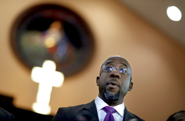 FILE -  In this Jan. 12, 2018 file photo Rev. Raphael Warnock speaks at Ebenezer Baptist Church in Atlanta.  Former President Barack Obama is endorsing Warnock in the race to fill a U.S. Senate seat in Georgia. Warnock is one of the Democrats running in a crowded field for the special election to be held Nov. 3, 2020. The seat is currently held by Republican Kelly Loeffler, a wealthy businesswoman who was appointed earlier this year by Republican Gov. Brian Kemp.  (AP Photo/David Goldman, File)