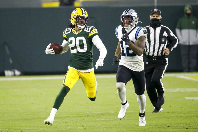 Green Bay Packers' Kevin King runs back a fumble in front of Carolina Panthers' D.J. Moore during the first half of an NFL football game Saturday, Dec. 19, 2020, in Green Bay, Wis. (AP Photo/Mike Roemer)