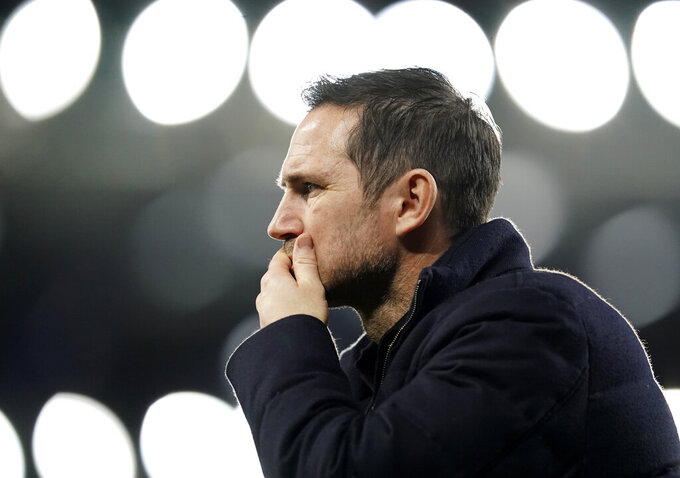FILE - In this Saturday, Dec. 12, 2020 file photo, Chelsea's head coach Frank Lampard walks during the warm up before the English Premier League soccer match between Everton and Chelsea at Goodison Park in Liverpool, England. Lampard has been fired by Chelsea halfway through his second season in charge of the London club on Monday, Jan. 25, 2021 after being unable to replicate his success as the club's record scorer in his first Premier League managerial job. Chelsea has lost five of its last eight Premier League games and dropped to ninth place, despite Lampard benefiting from nearly $300 million on new players for this season.  (AP Photo/Jon Super,Pool, File)
