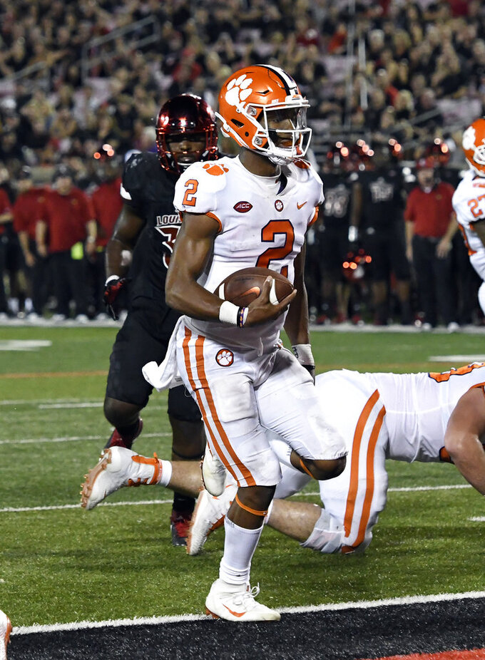 Clemson's Kelly Bryant (2) crosses the goal line to score during the second half of their NCAA college football game against Louisville, Saturday, Sept. 16, 2017, in Louisville, Ky. Clemson won 47-21. (AP Photo/Timothy D. Easley)