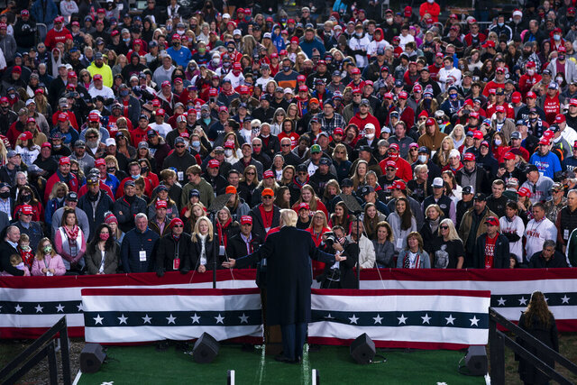 FILE - In this Oct. 24, 2020, file photo, President Donald Trump speaks during a campaign rally in Circleville, Ohio. Trump's 2020 reelection campaign was powered by a cell phone app that allowed staff to monitor the movements of his millions of supporters, and offered intimate access to their social networks. The app lets Trump's team communicate directly with the 2.8 million people who downloaded it and if they gave permission, with their entire contact list as well. (AP Photo/Evan Vucci, File)