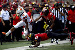 Syracuse running back Moe Neal (21) is forced out of bounds by Maryland defensive backs Tino Ellis (7) and Deon Jones (14) during the first half of an NCAA college football game, Saturday, Sept. 7, 2019, in College Park, Md. (AP Photo/Will Newton)
