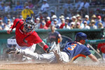 Houston Astros' Myles Straw slides safely into home plate as Boston Red Sox catcher Christian Vazquez is too late with the tag during a spring training baseball game, Thursday, March 5, 2020, in Fort Myers, Fla. (AP Photo/Elise Amendola)