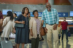 """This image released by Netflix shows Alfre Woodard, from left, Thedra Porter and Frankie Faison in a scene from """"Fatherhood."""" (Philippe Bosse/Netflix via AP)"""