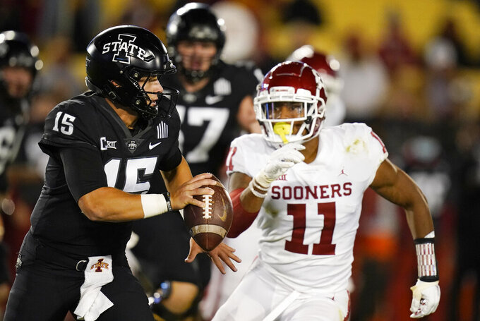 Iowa State quarterback Brock Purdy (15) runs from Oklahoma linebacker Nik Bonitto (11) during the second half an NCAA college football game, Saturday, Oct. 3, 2020, in Ames, Iowa. Iowa State won 37-30. (AP Photo/Charlie Neibergall)