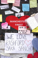 A view of the messages of support left on a mural of Manchester United striker and England player Marcus Rashford, on the wall of the Coffee House Cafe on Copson Street, in Withington, Manchester, England, Tuesday July 13, 2021. The mural was defaced with graffiti in the wake of England losing the Euro 2020 soccer championship final match to Italy. (AP Photo/Jon Super)