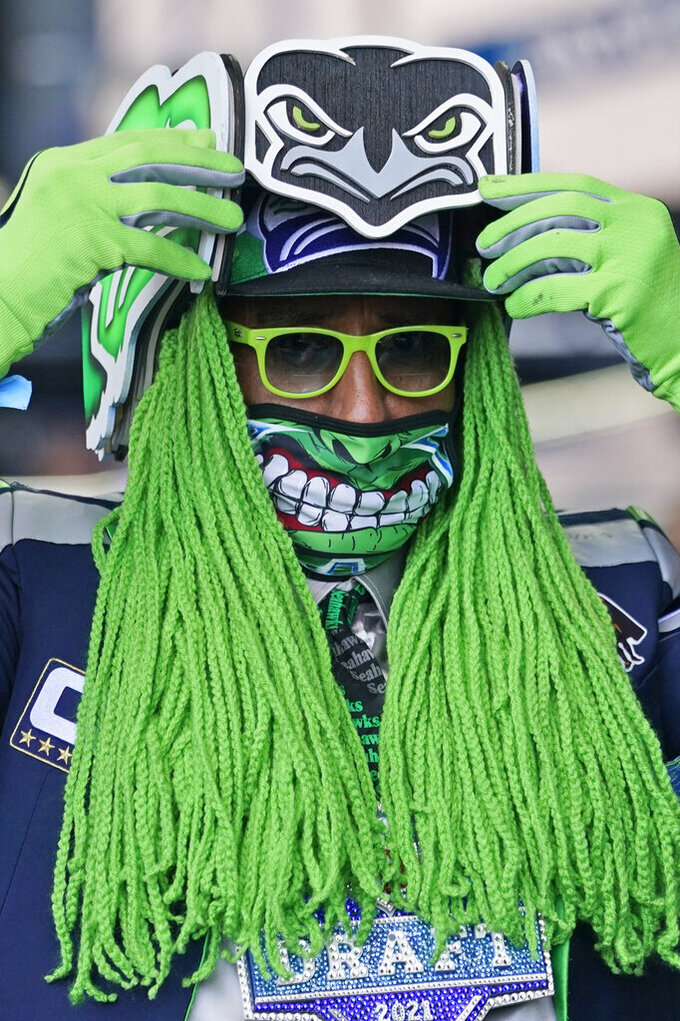 Seattle Seahawks fan Wallace Watts watches the fourth round of the NFL football draft, Saturday, May 1, 2021, in Cleveland. (AP Photo/Tony Dejak)