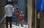 Kashmiri children play with toy guns in an ally in Srinagar, Indian controlled Kashmir Wednesday, June 13, 2018. (AP Photo/Mukhtar Khan)