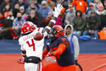 Rutgers defensive back Tim Barrow (4) breaks up a pass in the endzone intended for Illinois tight end Daniel Barker during the first half of an NCAA college football game Saturday, Nov. 2, 2019, in Champaign, Ill. (AP Photo/Charles Rex Arbogast)