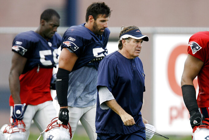 FILE - In this July 28, 2007, file photo, New England Patriots head coach Bill Belichick, center, walks with linebackers Rosevelt Colvin, left, and Mike Vrabel during NFL football training camp in Foxborough, Mass. Vrabel is now the head coach of the Tennessee Titans. (AP Photo/Winslow Townson, File)