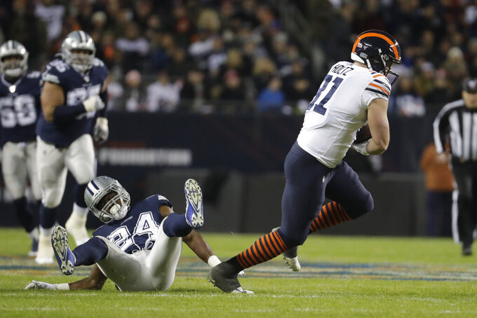 Chicago Bears' J.P. Holtz (81) runs out of a tackle of Dallas Cowboys' Chidobe Awuzie (24) during the first half of an NFL football game, Thursday, Dec. 5, 2019, in Chicago. (AP Photo/Morry Gash)