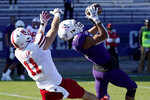 Northwestern defensive back Brandon Joseph, right, intercepts a pass intended for Nebraska tight end Austin Allen during the second half of an NCAA college football game in Evanston, Ill., Saturday, Nov. 7, 2020. Northwestern won 21-13. (AP Photo/Nam Y. Huh)