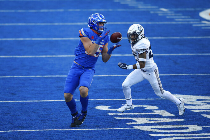 Boise State tight end John Bates (85) turns to catch the ball as Utah State cornerback Jarrod Green (25) closes in on him in the first half of an NCAA college football game Saturday, Oct. 24, 2020, in Boise, Idaho. (AP Photo/Steve Conner)
