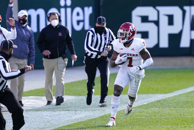 Rutgers defensive back Brendon White (7) looks toward the bench after intercepting a pass in the closing minutes of the second half of an NCAA college football game against Michigan State, Saturday, Oct. 24, 2020, in East Lansing, Mich. (AP Photo/Carlos Osorio)