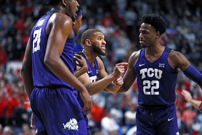 TCU's Edric Dennis Jr. (2) talks to his teammates during the first half of an NCAA college basketball game against Texas Tech, Monday, Feb. 10, 2020, in Lubbock, Texas. (AP Photo/Brad Tollefson)