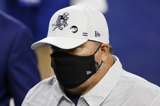 "Dallas Cowboys head coach Mike McCarthy wears a ball cap that has a ""MP"" sticker on it as he walks off the field after their NFL football game against the Washington Football Team in Arlington, Texas, Thursday, Nov. 26, 2020. The sticker is in memory of Markus Paul, their strength and conditioning coordinator who died on Wednesday. (AP Photo/Ron Jenkins)"