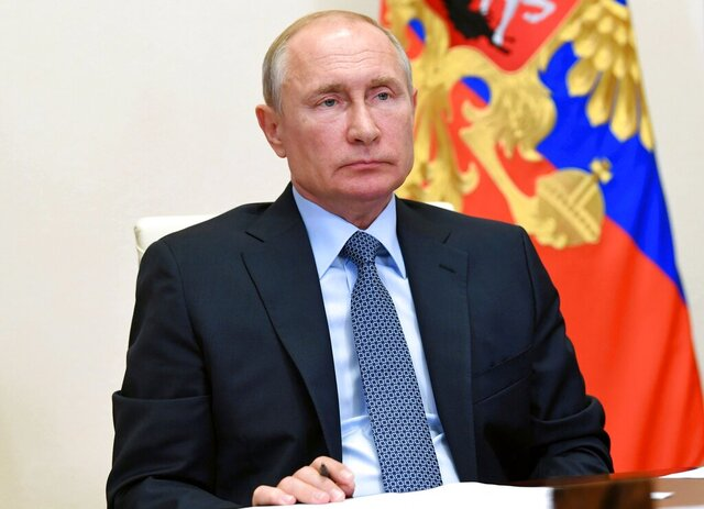 Russian President Vladimir Putin attends a video call on dealing with the aftermath of a fuel spill in the Arctic at the Novo-Ogaryovo residence outside Moscow, Russia, Friday, June 19, 2020. A power plant in Norilsk leaked 20,000 tons of diesel fuel into the ecologically fragile region last month, fouling waterways in the area. (Alexei Nikolsky, Sputnik, Kremlin Pool Photo via AP)