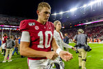 Alabama quarterback Mac Jones (10) walks off the field after an NCAA college football game against Arkansas, Saturday, Oct. 26, 2019, in Tuscaloosa, Ala. (AP Photo/Vasha Hunt)