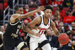 Louisville guard David Johnson (13) drives the ball up court as he's pressured by Wake Forest guard Torry Johnson (11) during the first half of an NCAA college basketball game Wednesday, Feb. 5, 2020, in Louisville, Ky. (AP Photo/Wade Payne)
