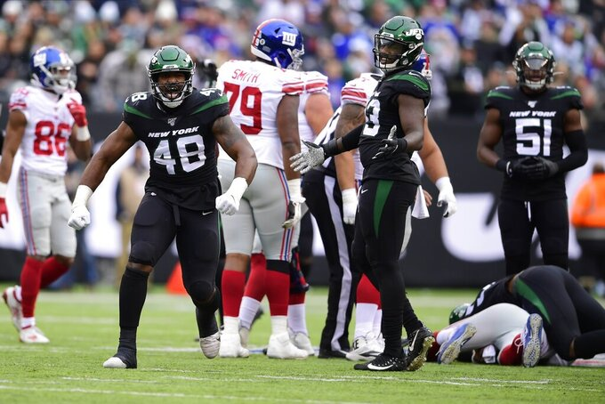 New York Jets outside linebacker Jordan Jenkins (48) celebrates after sacking New York Giants quarterback Daniel Jones (8) during the first half of an NFL football game Sunday, Nov. 10, 2019, in East Rutherford, N.J. (AP Photo/Steven Ryan)