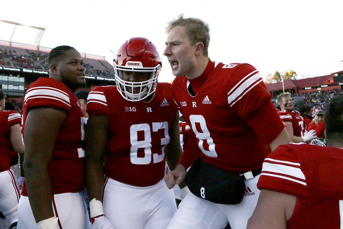 Rutgers quarterback Artur Sitkowski (8) celebrates with teammates after Isaih Pacheco scored on a touchdown run against Michigan during the first half of an NCAA college football game, Saturday, Nov. 10, 2018, in Piscataway, N.J. (AP Photo/Julio Cortez)