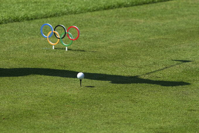 Xander Schauffele, of the United States hits a tee shot on the 14th hole during the final round of the men's golf event at the 2020 Summer Olympics on Sunday, Aug. 1, 2021, in Kawagoe, Japan. (AP Photo/Andy Wong)