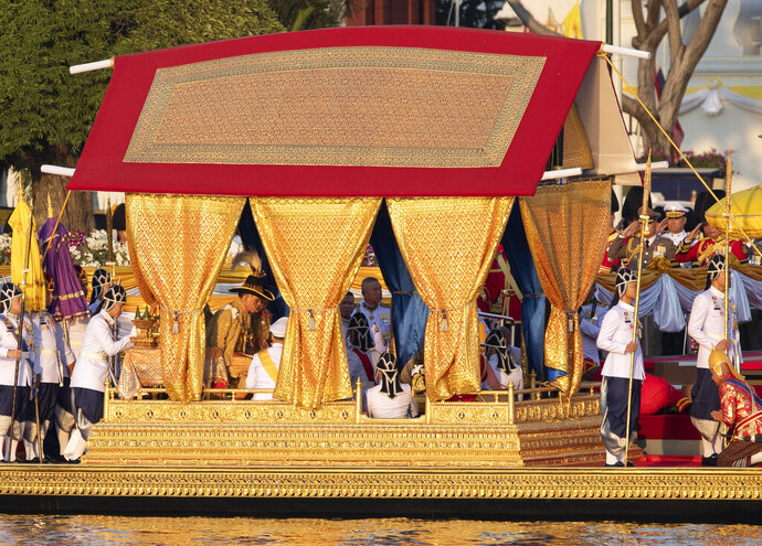 Oarsmen paddle the royal barge carrying King Maha Vajiralongkorn and Queen Suthida during the Royal Barge Precession on the Chao Phraya River Bangkok, Thailand, Thursday, Dec. 12, 2019. The Royal Barge Procession event is part of the coronation of Thailand's King Maha Vajiralongkorn. (AP Photo/Sakchai Lalit)