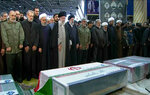 In this photo released by the official website of the Office of the Iranian Supreme Leader, supreme leader Ayatollah Ali Khamenei, fourth from left, leads a prayer over the coffins of Gen. Qassem Soleimani and his comrades, who were killed in Iraq in a U.S. drone strike on Friday, at the Tehran University campus, in Tehran, Iran, Monday, Jan. 6, 2020. (Office of the Iranian Supreme Leader via AP)