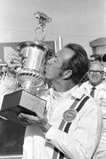 FILE - In this Feb. 13, 1971, file photo, Red Farmer kisses the trophy after winning the Permatex 300 stock car race at Daytona International Speedway in Daytona Beach, Fla. Farmer is a contender for NASCAR's 2021 Hall of Fame class, to be announced Tuesday, June 16, 2020. (AP Photo/George Brich, File)