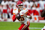 Kansas City Chiefs quarterback Patrick Mahomes (15) looks to throw against the Arizona Cardinals during the first half of an NFL football game, Friday, Aug. 20, 2021, in Glendale, Ariz. (AP Photo/Ross D. Franklin)