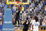 Colorado guard Eli Parquet (24) dunks against UCLA during the second half of an NCAA college basketball game Saturday, Jan. 2, 2021, in Los Angeles. (AP Photo/Marcio Jose Sanchez)