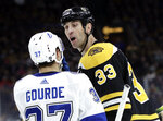 Boston Bruins defenseman Zdeno Chara (33) has words with Tampa Bay Lightning center Yanni Gourde (37) in the first period of an NHL hockey game, Thursday, Feb. 28, 2019, in Boston. (AP Photo/Elise Amendola)