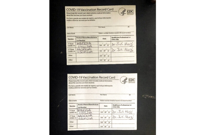 This undated image provided by the United States District Court for the Northern District of California shows two fake CDC COVID-19 Vaccination Record Cards that are part of a criminal complaint. With more than 600 colleges and universities now requiring proof of COVID-19 inoculations, an online industry has sprung up offering fake vaccine cards. Dozens of students interviewed by the Associated Press said they were aware of fake covid-19 vaccination cards, though none admitted to actually using one.  (U.S. District Court for the Northern District of California via AP)