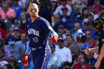 Chicago Cubs' Trayce Thompson throws his helmet after striking out swinging during the fourth inning in the first baseball game of a doubleheader against the St. Louis Cardinals in Chicago, Friday, Sept. 24, 2021. (AP Photo/Nam Y. Huh)