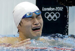 FILE - In this Saturday, Aug. 4, 2012 file photo, China's Sun Yang is overcome by emotion after his gold medal win in the men's 1500-meter freestyle swimming final at the Aquatics Centre in the Olympic Park during the 2012 Summer Olympics in London. One of China's biggest Olympic stars will undergo a rare public trial of a doping case on Friday, Nov. 15, 2019 with his 2020 Tokyo Games place at stake. Three-time gold medalist swimmer Sun Yang is facing a World Anti-Doping Agency appeal in Switzerland that seeks to ban him for up eight years. (AP Photo/Michael Sohn, File)