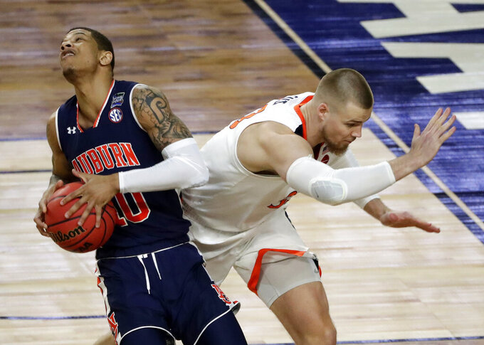 Auburn's Samir Doughty (10) battles for a rebound against Virginia's Jack Salt (33) during the first half in the semifinals of the Final Four NCAA college basketball tournament, Saturday, April 6, 2019, in Minneapolis. (AP Photo/Matt York)