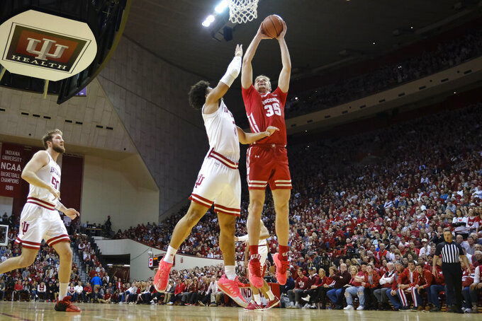 Wisconsin forward Nate Reuvers (35) shoots in front of Indiana forward Justin Smith (3) in the second half of an NCAA college basketball game in Bloomington, Ind., Saturday, March 7, 2020. Wisconsin won 60-56. (AP Photo/AJ Mast)