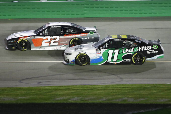 Austin Cindric (22) and Justin Haley (11) work on the track during a NASCAR Xfinity Series auto race Thursday, July 9, 2020, in Sparta, Ky. (AP Photo/Mark Humphrey)