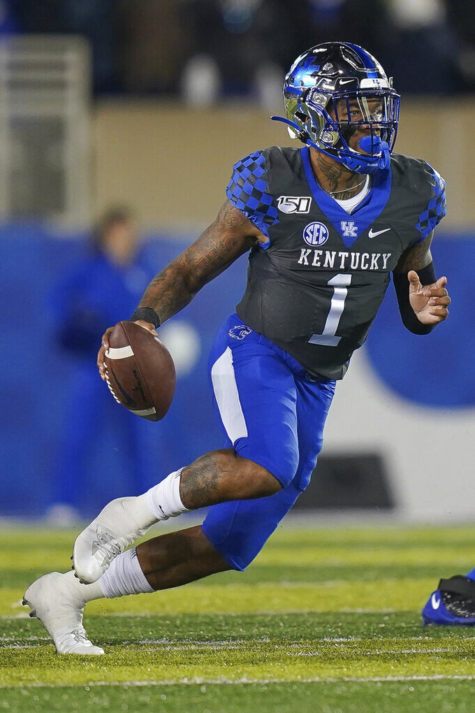 Kentucky quarterback Lynn Bowden Jr. (1) runs with the ball during the first half of an NCAA college football game against Tennessee, Saturday, Nov. 9, 2019, in Lexington, Ky. (AP Photo/Bryan Woolston)