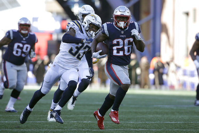 New England Patriots running back Sony Michel (26) runs away from Los Angeles Chargers free safety Derwin James (33) during the first half of an NFL divisional playoff football game, Sunday, Jan. 13, 2019, in Foxborough, Mass. (AP Photo/Steven Senne)