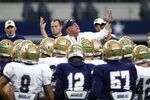 Notre Dame head coach Brian Kelly gestures as he speaks to his team during practice at AT&T Stadium in Arlington, Texas, Monday, Dec. 24, 2018. Notre Dame is scheduled to play Clemson in the NCAA Cotton Bowl semi-final playoff Saturday. (AP Photo/Jim Cowsert)