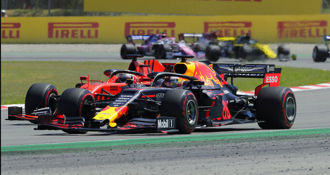 Red Bull driver Max Verstappen of the Netherland's overtakes Ferrari driver Sebastian Vettel of Germany during the Spanish Formula One race at the Barcelona Catalunya racetrack in Montmelo, just outside Barcelona, Spain, Sunday, May 12, 2019. (AP Photo/Manu Fernandez)