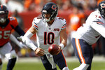 Chicago Bears quarterback Mitchell Trubisky (10) hands off against the Denver Broncos during the first half of an NFL football game, Sunday, Sept. 15, 2019, in Denver. (AP Photo/David Zalubowski)