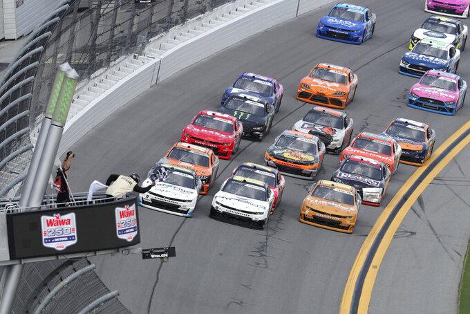 Justin Haley, front left, edges out AJ Allmendinger, center, to win the NASCAR Xfinity Series auto race at Daytona International Speedway, Saturday, Aug. 28, 2021, in Daytona Beach, Fla. (AP Photo/David Graham)