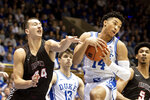Duke's Jordan Goldwire (14) gathers a rebound ahead of Brown's Matt DeWolf (44) during the first half of an NCAA college basketball game in Durham, N.C., Saturday, Dec. 28, 2019. (AP Photo/Ben McKeown)