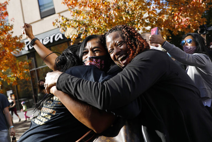 People celebrate Saturday, Nov. 7, 2020, in Philadelphia, after Democrat Joe Biden defeated President Donald Trump to become 46th president of the United States. (AP Photo/Rebecca Blackwell)