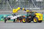 Alpha Tauri car of Daniil Kvyat of Russia is carried off track after crashing during the British Formula One Grand Prix at the Silverstone racetrack, Silverstone, England, Sunday, Aug. 2, 2020. (Andrew Boyers/Pool via AP)