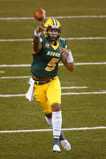 North Dakota State quarterback Trey Lance passes against Central Arkansas in the first quarter of an NCAA college football game Saturday, Oct. 3, 2020, in Fargo, N.D. (AP Photo/Bruce Kluckhohn)