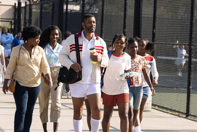 """This image released by Warner Bros. Pictures shows, from left, Aunjanue Ellis as Oracene """"Brandi"""" Williams, Mikayla Bartholomew as Tunde Price, Will Smith as Richard Williams, Saniyya Sidney as Venus Williams, Demi Singleton as Serena Williams and Danielle Lawson as Isha Price in """"King Richard."""" (Warner Bros. Pictures via AP)"""